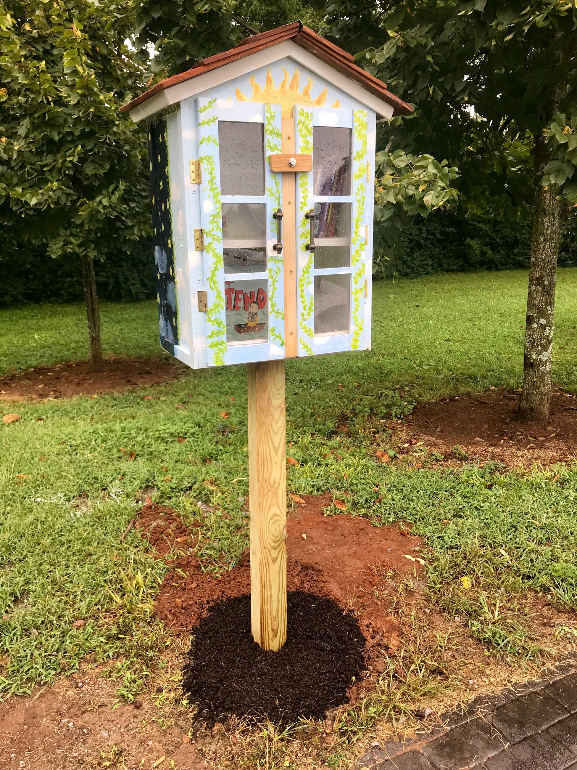 Little Library located on the Breezeway Restorative Trail built & painted by local students