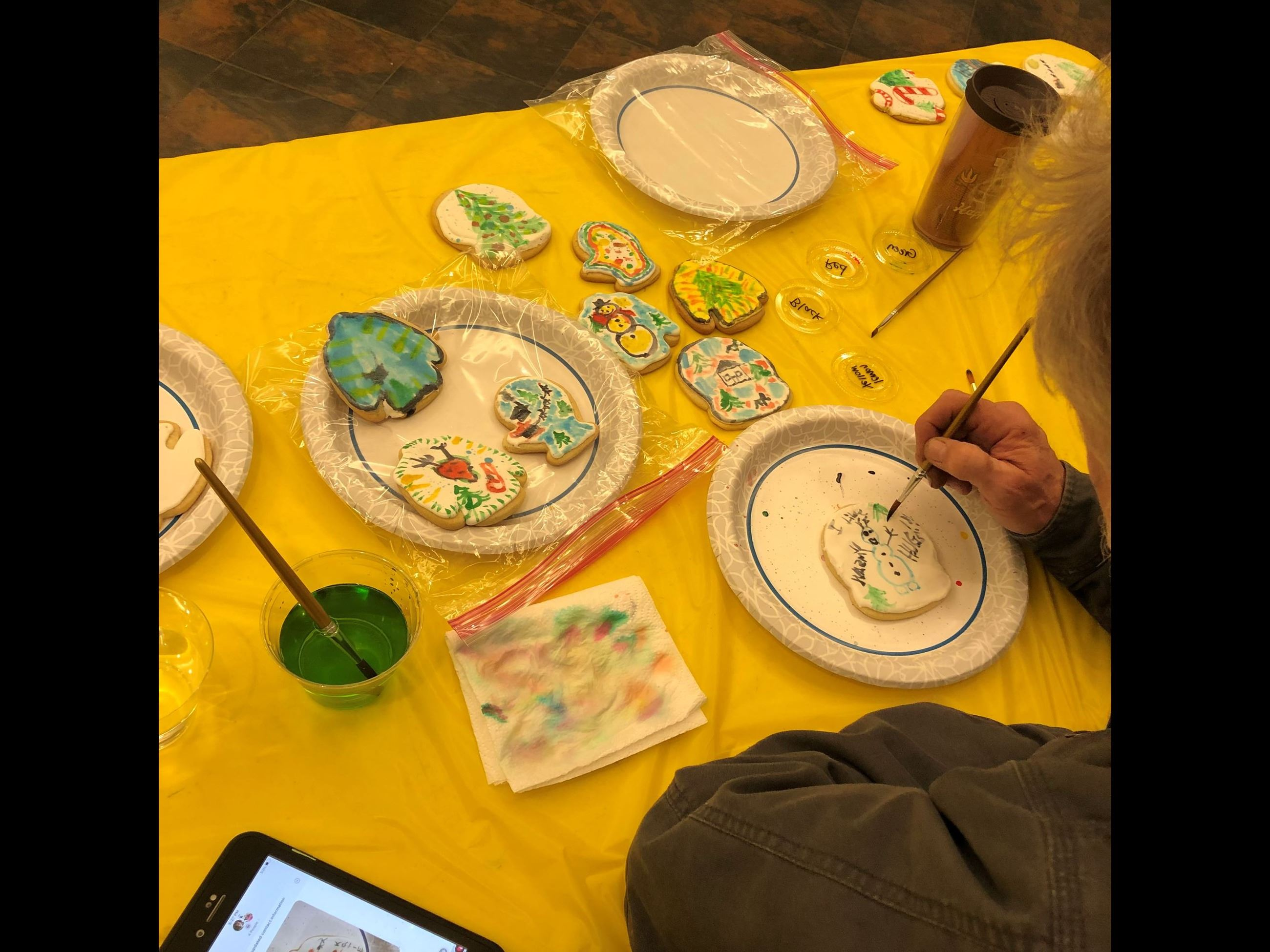 Program participant painting water color cookies